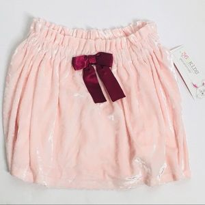 Pink velour skirt with bow and elastic waistband